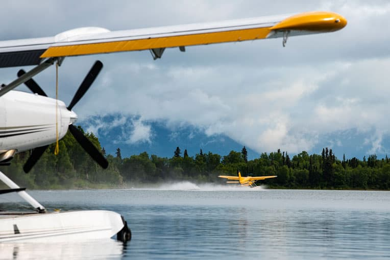 Samaritan's Purse floatplanes, pictured in the foreground and distance, carry military couples into pristine places in the Alaska wilderness.