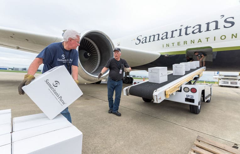 Our team loads supplies onto the DC-8.