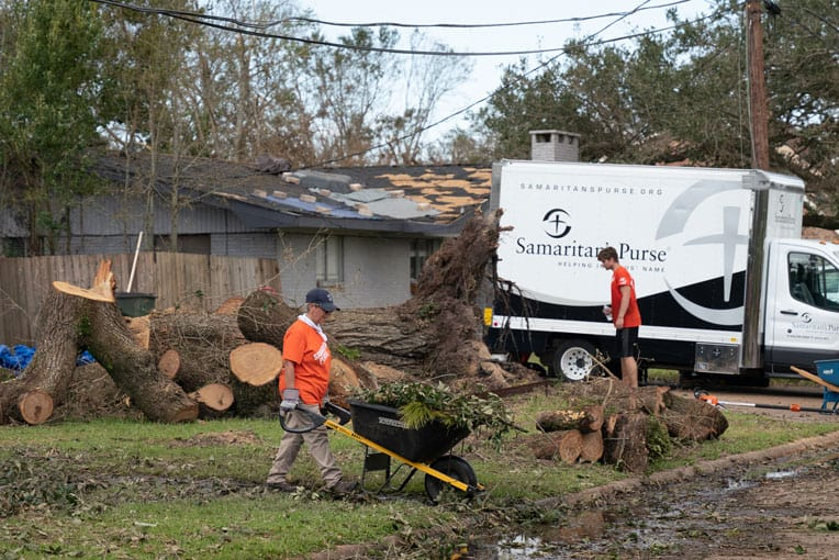 Volunteers are clearing trees and yard debris across southern Louisiana.