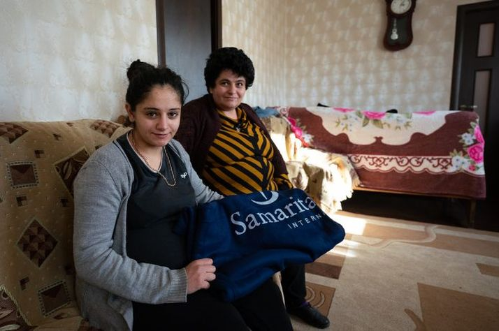 Lisa, left, and Nasely fled their home with little more than the clothes they were wearing. Blankets and other winter supplies will protect against the already-harsh winter months.