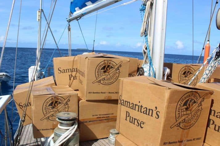 A team of missionaries and volunteers brought 30 cartons of Operation Christmas Child shoeboxes from the island of Ebeye to Ennubir by sailboat.