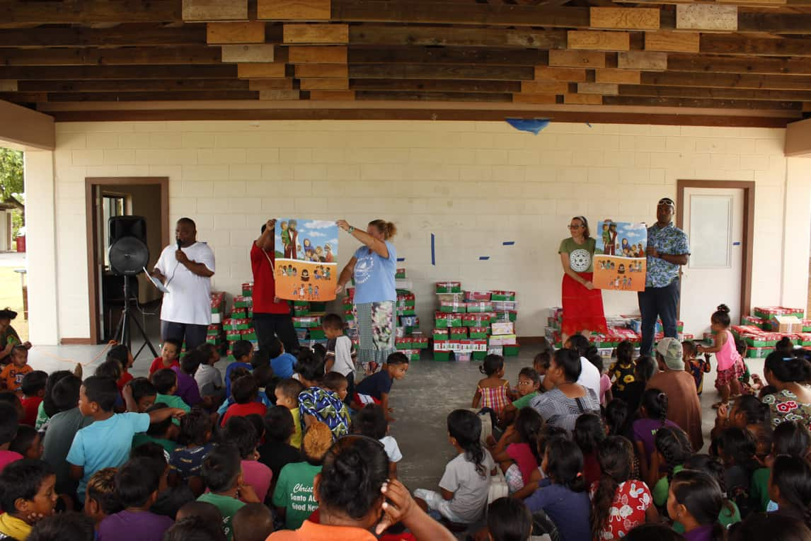 Volunteers presented the Gospel to an eager crowd of children and parents before they distributed the shoebox gifts.