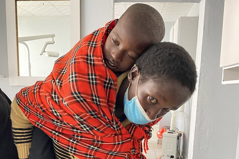 Emma carried her 10-year-old son Sylvanus to the dental clinic at Kapsowar.