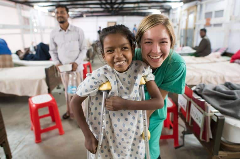 Erin Stephenson, a nurse serving through Samaritan's Purse, smiles with her patient at Memorial Christian Hospital.