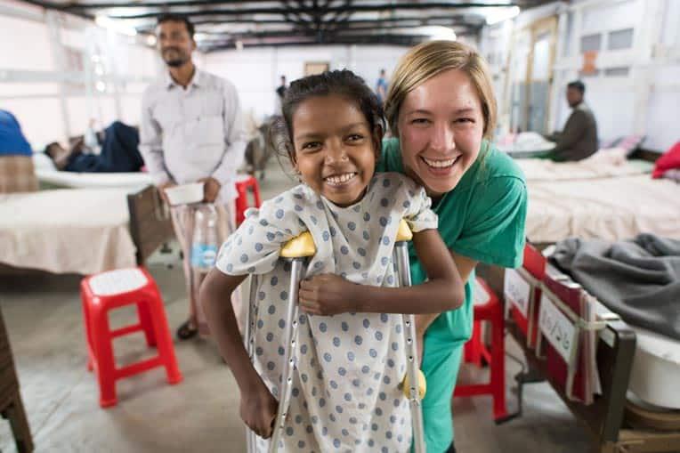 Erin Stephenson, a nurse serving through Samaritan's Purse, smiles with her patient at Memorial Christian Hospital.