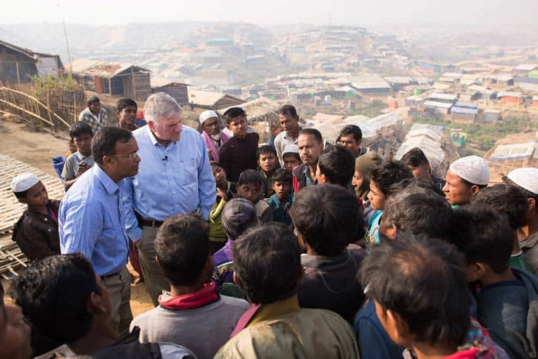 Samaritan's Purse President Franklin Graham speaks with a crowd of Rohingya refugees.