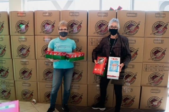 Lori Bettig and Barbara Shumeley at Grant Memorial Church after Shumeley dropped off over 800 boxes. (Supplied)