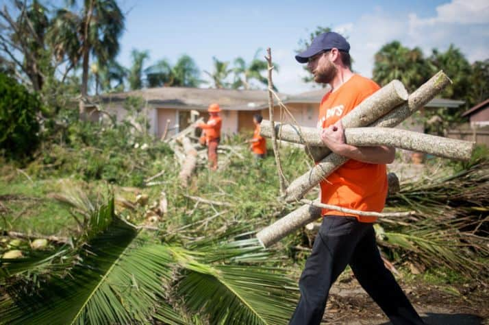 Volunteers are working hard clearing debris and fallen trees in Naples, Florida.