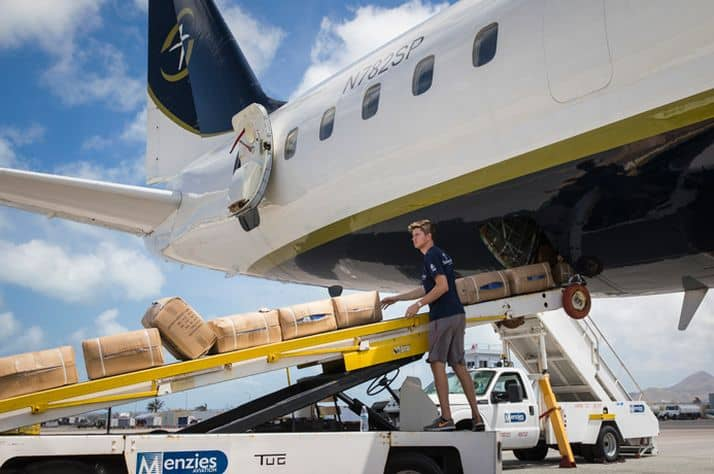 A staff member unloads relief supplies in St. Martin.