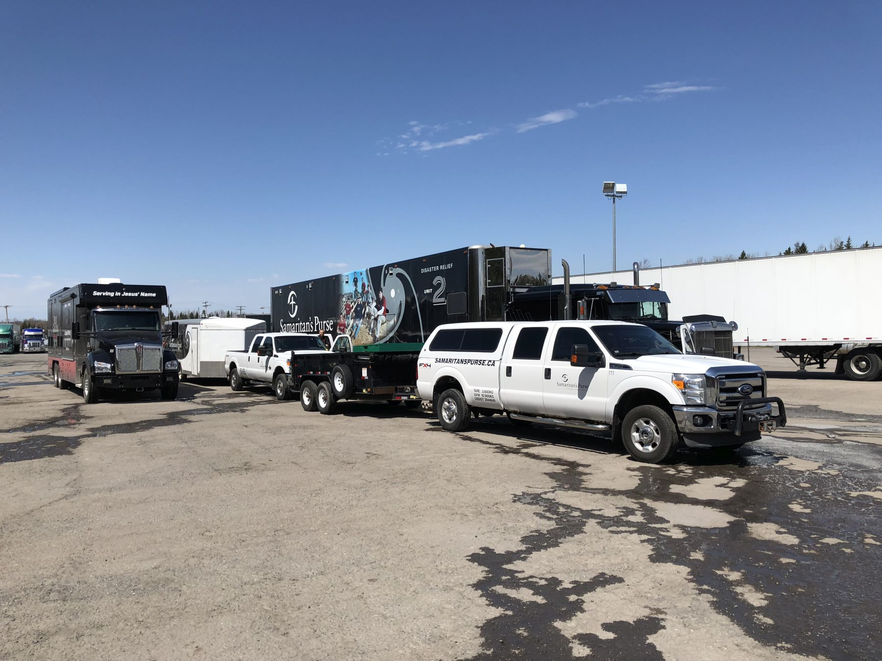 Samaritan's Purse's Disaster Relief Units (pictured right) are outfitted with generators, pumps, hand tools, shovels, chainsaws, and safety gear for volunteers. The Mobile Ministry Center truck (left) is used by crisis-trained Rapid Response Team chaplains from our sister organization, the Billy Graham Evangelistic Association.