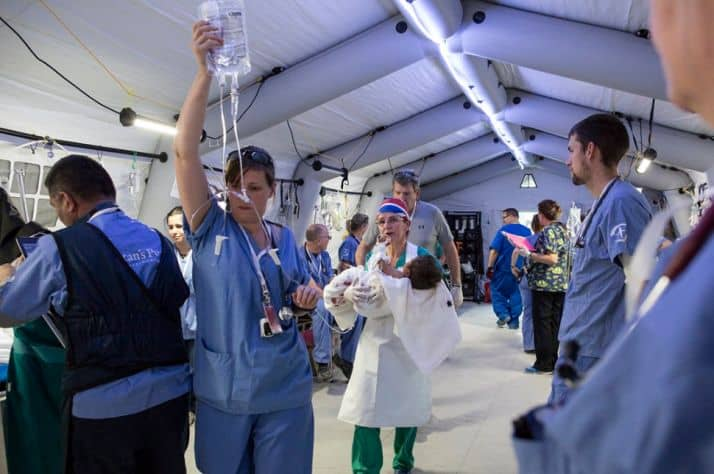 Samaritan's Purse medical personnel caring for severely injured patients at the Emergency Field Hospital in Iraq.