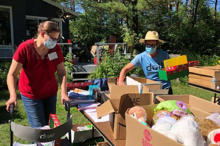 Friends of Operation Christmas Child in Wisconsin Rapids, Wisconsin, packed 138 shoebox gifts outside while wearing masks and social distancing.