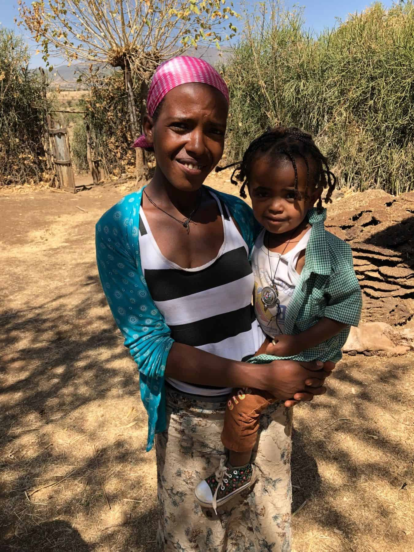 Frealem Eshetu holds her young daughter, the third generation in her family to benefit from the same 20-year-old BioSand Filter.