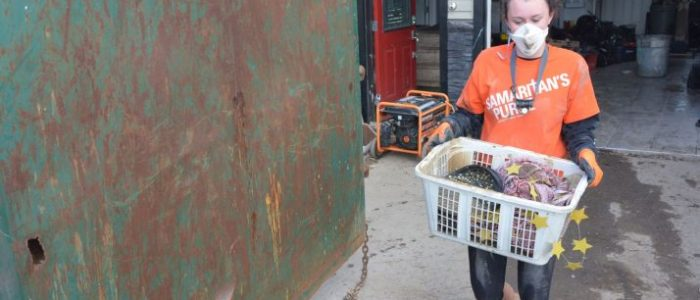 Cleaning out a flooded home is dirty, difficult work, but the volunteer teams do it with great love.