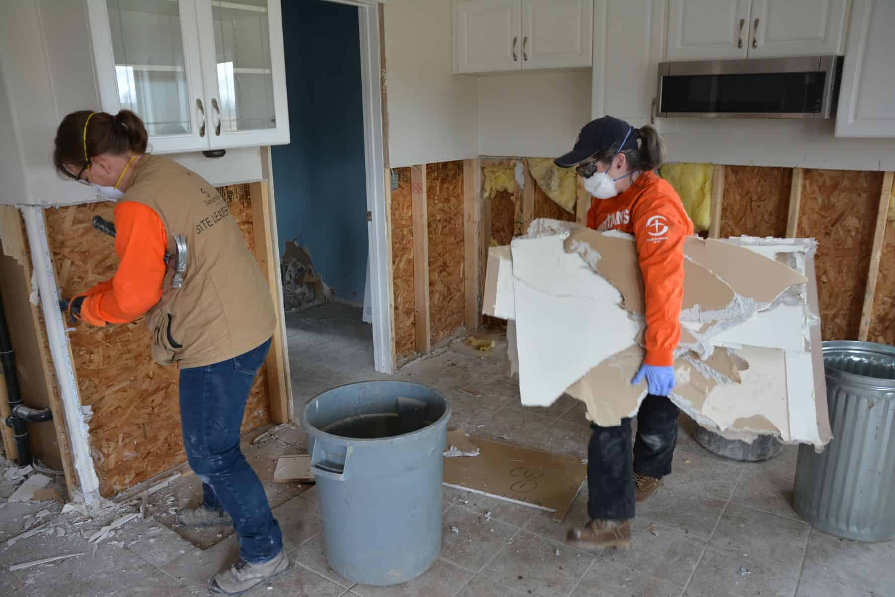 Volunteers remove damaged drywall from Gerry Gaunt's home in Fort McMurray.