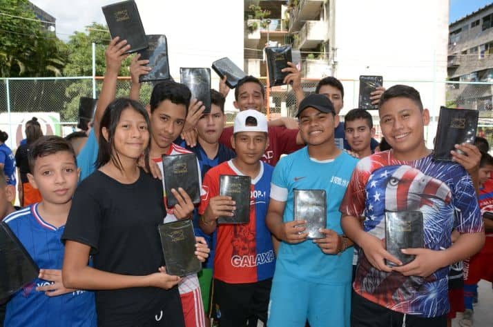 Thanks to the financial support of Canadians like you, Samaritan's Purse was able to give New Testaments to these soccer players in an El Salvador ghetto.