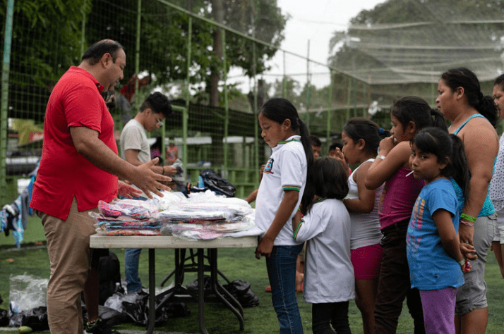Families receive clothing at a distribution with local partners.