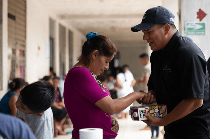 Angel Jordan spends time praying with hurting families during a food distribution.