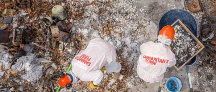 Samaritan's Purse volunteers sift through the ashes of Ean Newell's home in New South Wales, Australia.