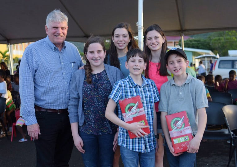 Franklin Graham with the grandchildren who accompanied him to shoebox distributions in Antigua.