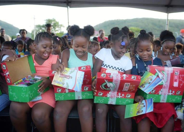Children in Antigua open their shoeboxes with delight!