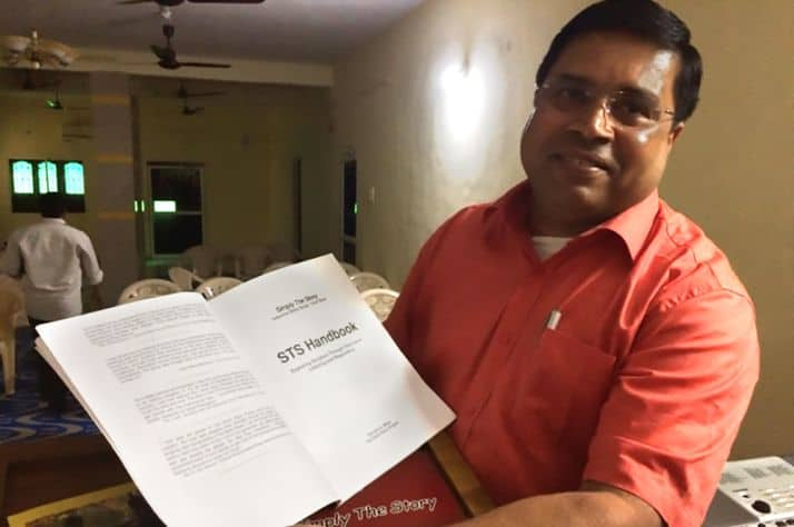 An instructor shows off a lesson plan that is used to equip and encourage pastors.