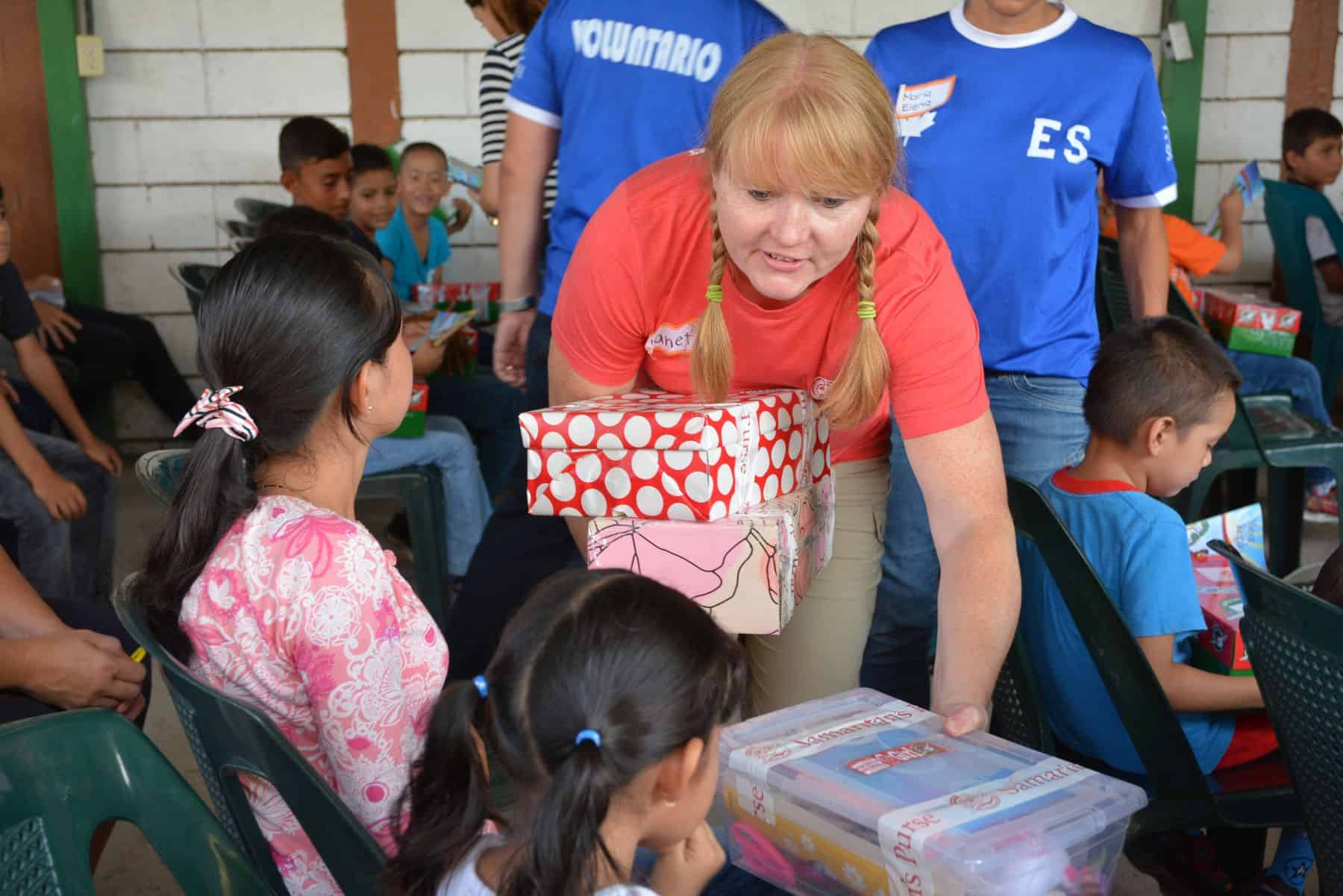 Calgarian Janet Olmstead hands out shoebox gifts at a distribution in El Salvador.
