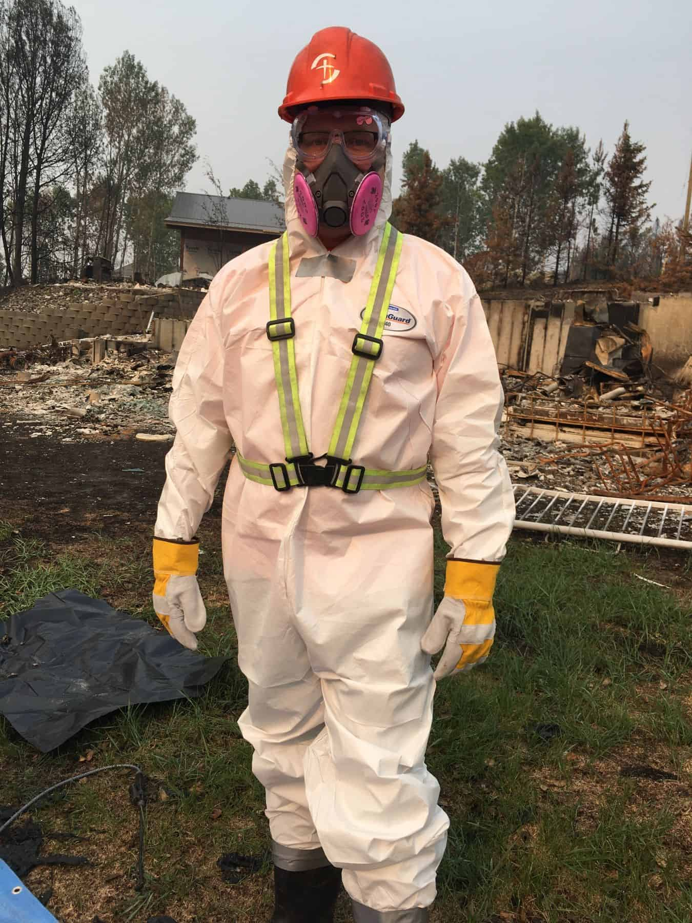 Jay McAlister, lead pastor of Calvary Church in Williams Lake, BC, wore Samaritan's Purse protective equipment as he joined volunteers helping residents who lost their homes and possessions to a wildfire.