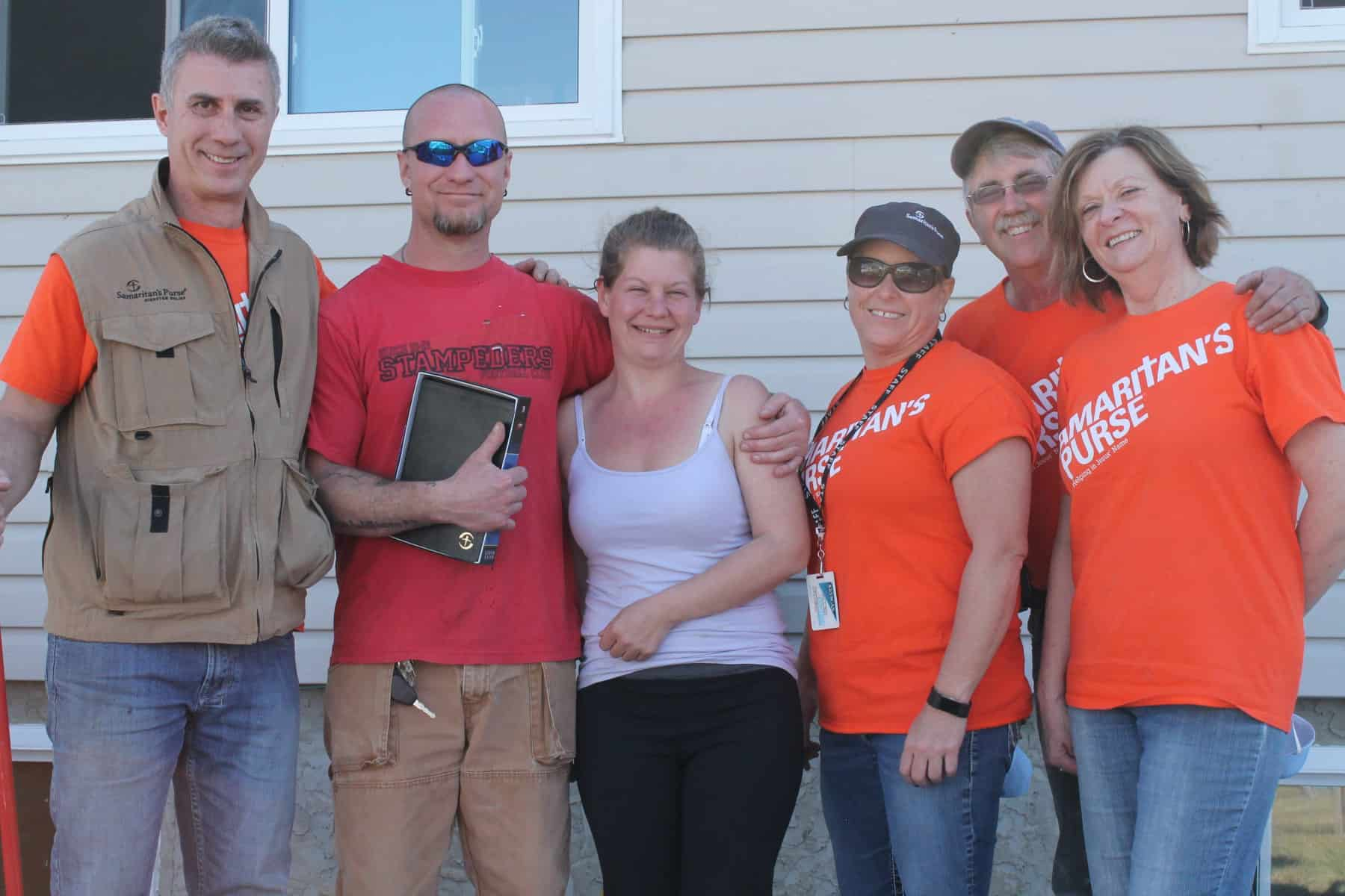 Samaritan's Purse volunteers presented Jen and Rob with a Bible they signed.