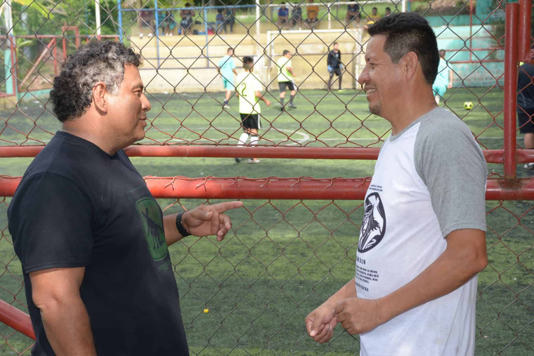 Jose Victor Dominguez (left), who operates our community development programs in El Salvador, speaks with Carlos Cruz, who oversees a Samaritan's Purse-sponsored soccer league.