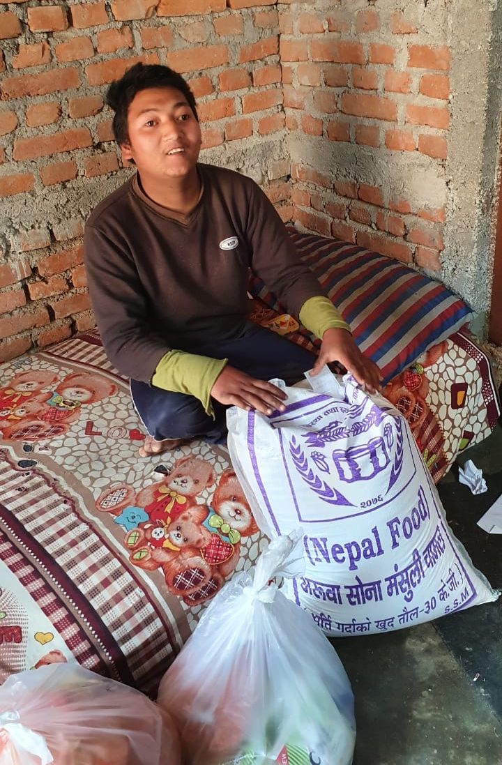 Manish welcomes a delivery of emergency food to help his family in Nepal survive the coronavirus pandemic.