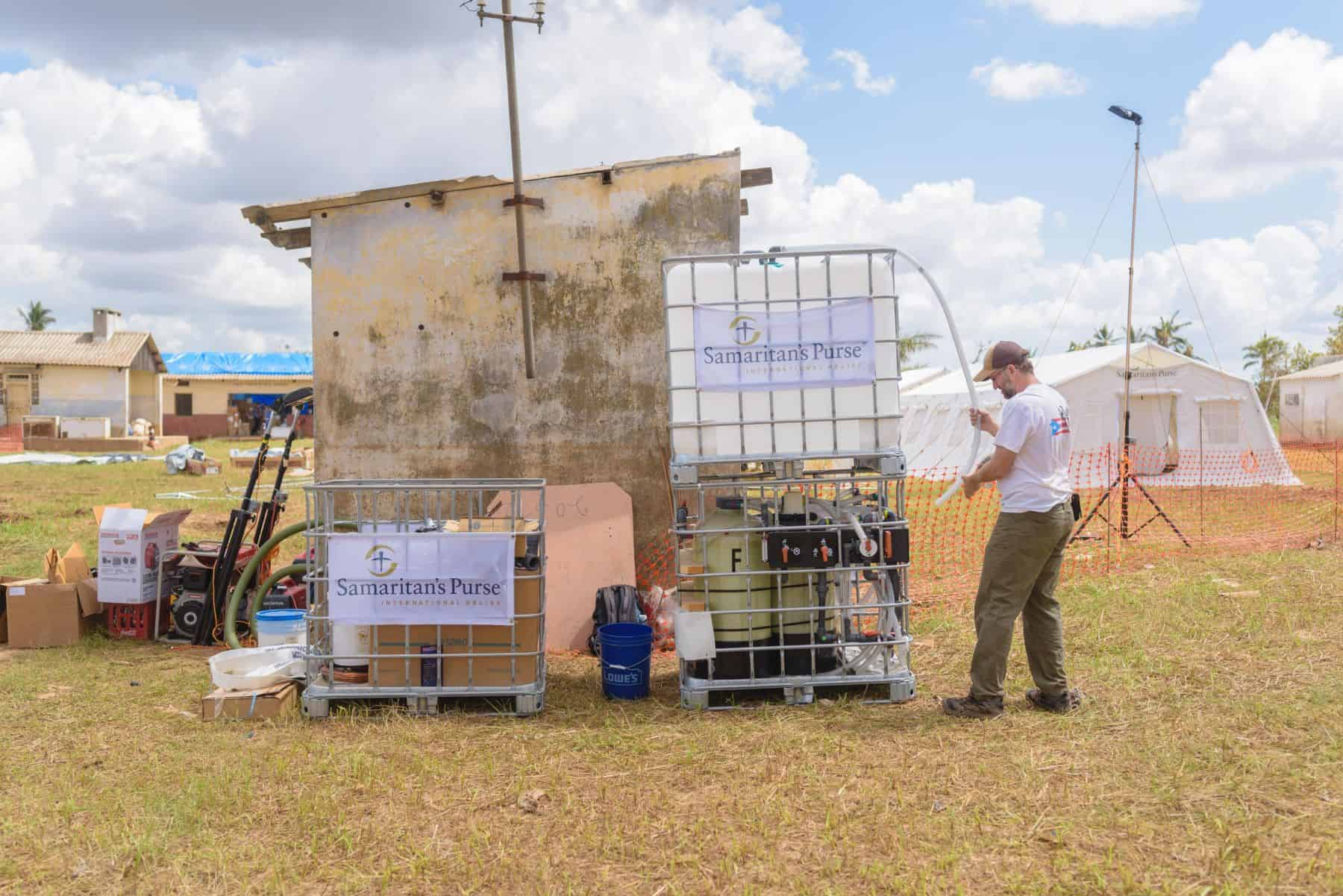 Canadian, Peter Roebuck, sets up a water treatment system in Mozambique. Peter is from Ottawa and is serving as the WASH (Water, Sanitation & Hygiene) lead for the team. The Emergency Field Hospital can be seen in the background.