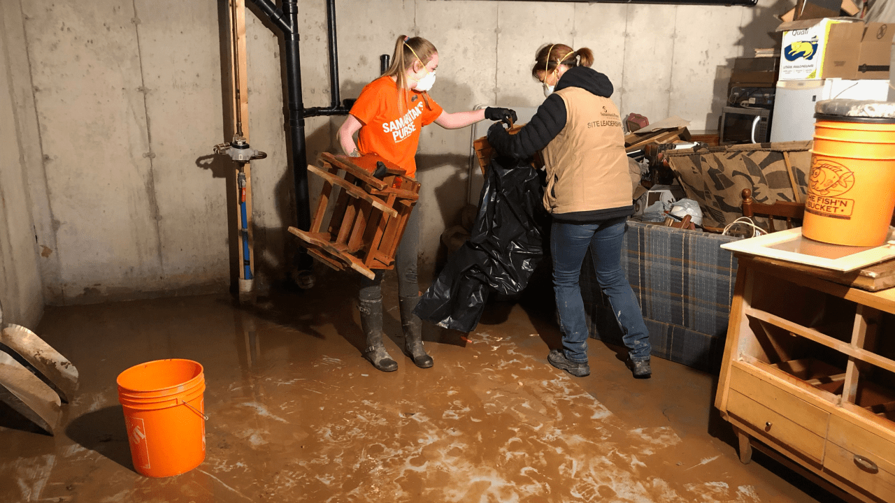 Samaritan's Purse team leaders and volunteers removed damaged possessions from a flooded basement in New Brunswick.