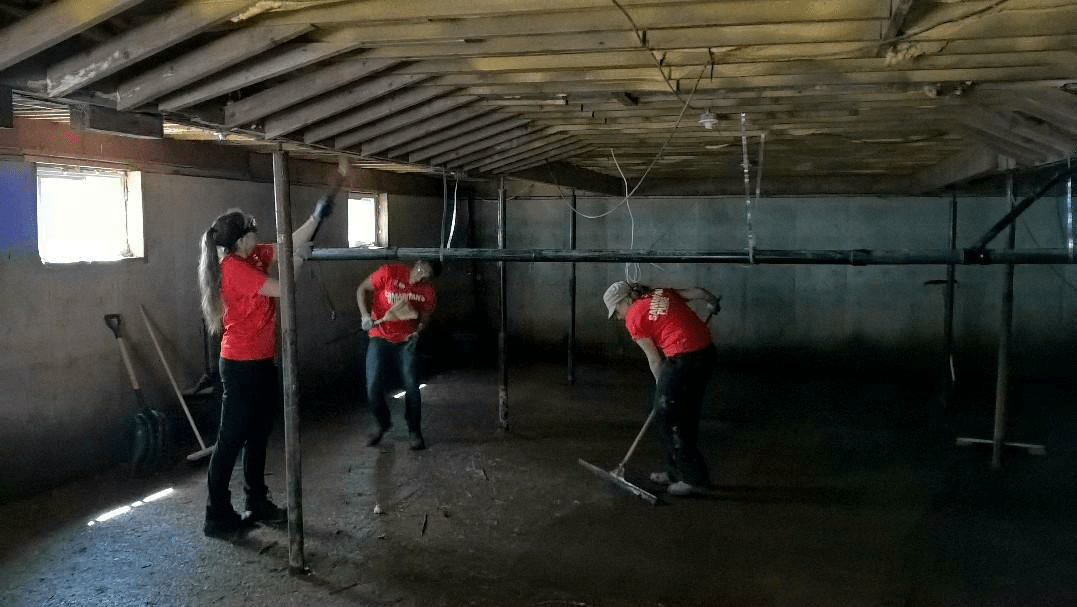 Samaritan's Purse volunteers clean out flooded basements in New Brunswick.