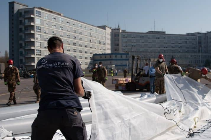 Samaritan's Purse staff help set up a tent that will serve as a temporary emergency field hospital to help care for coronavirus patients in Cremona, Italy, in March 2020.
