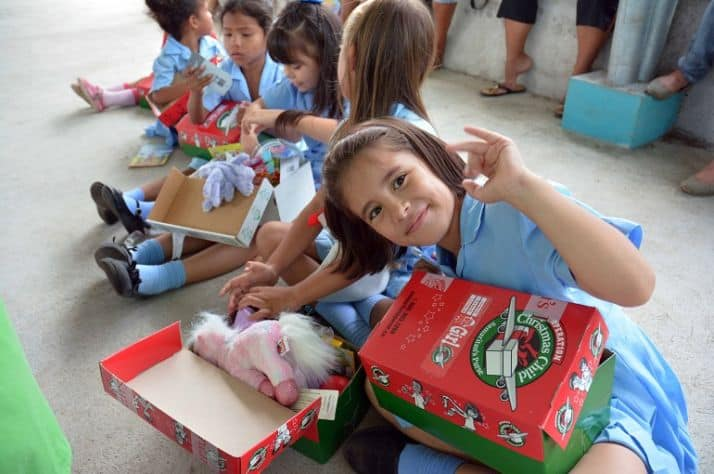 Children in Costa Rica checking out their Canadian-packed Operation Christmas Child shoeboxes.