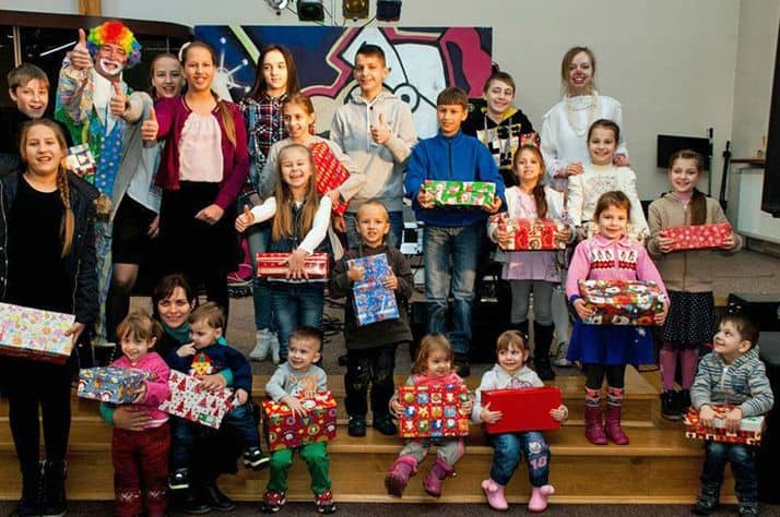 Refugee children receive Operation Christmas Child shoebox gifts in Poland.
