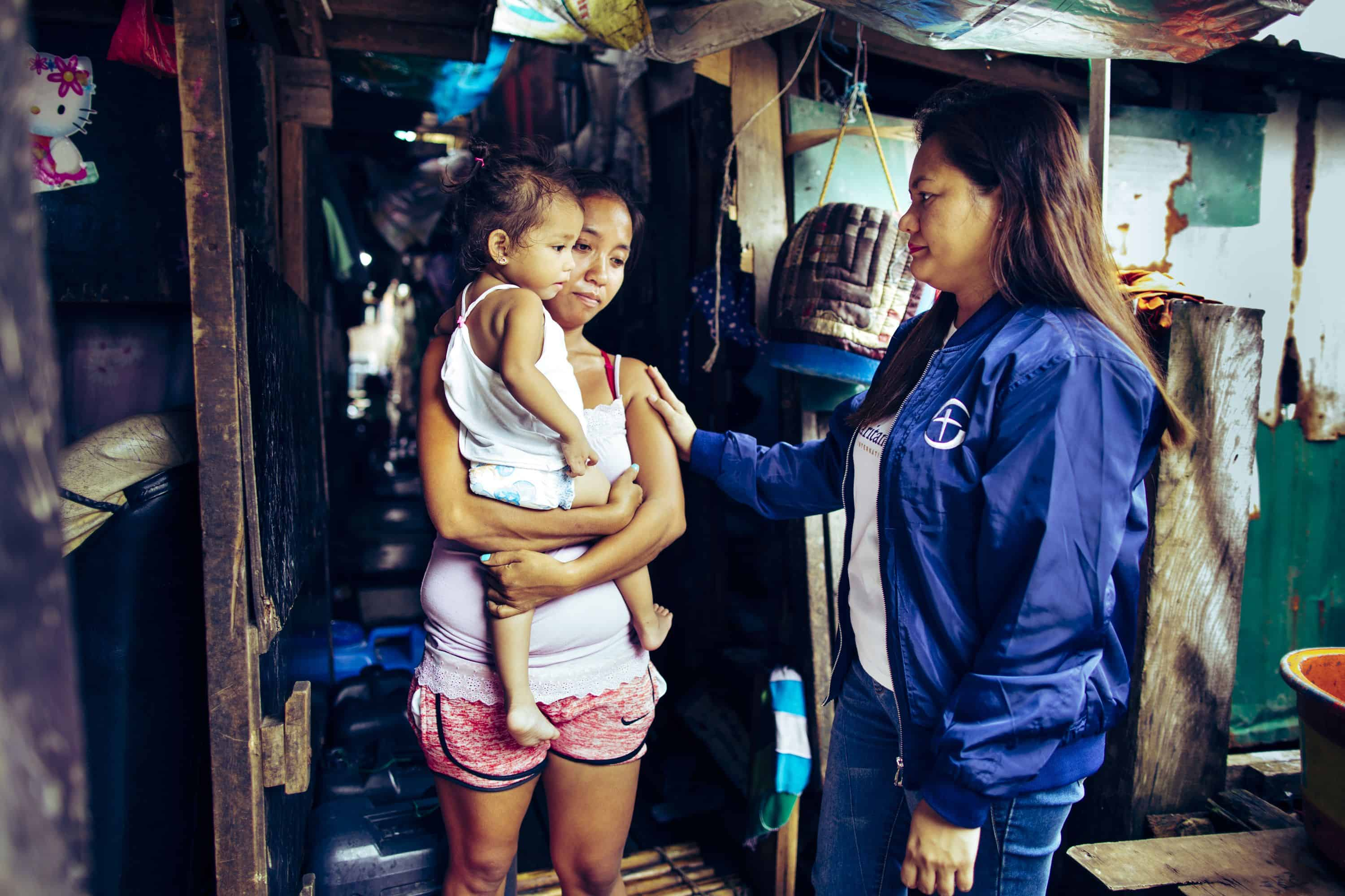 Samaritan's Purse staff show compassion in Jesus' Name to Tondo families struggling to make ends meet.
