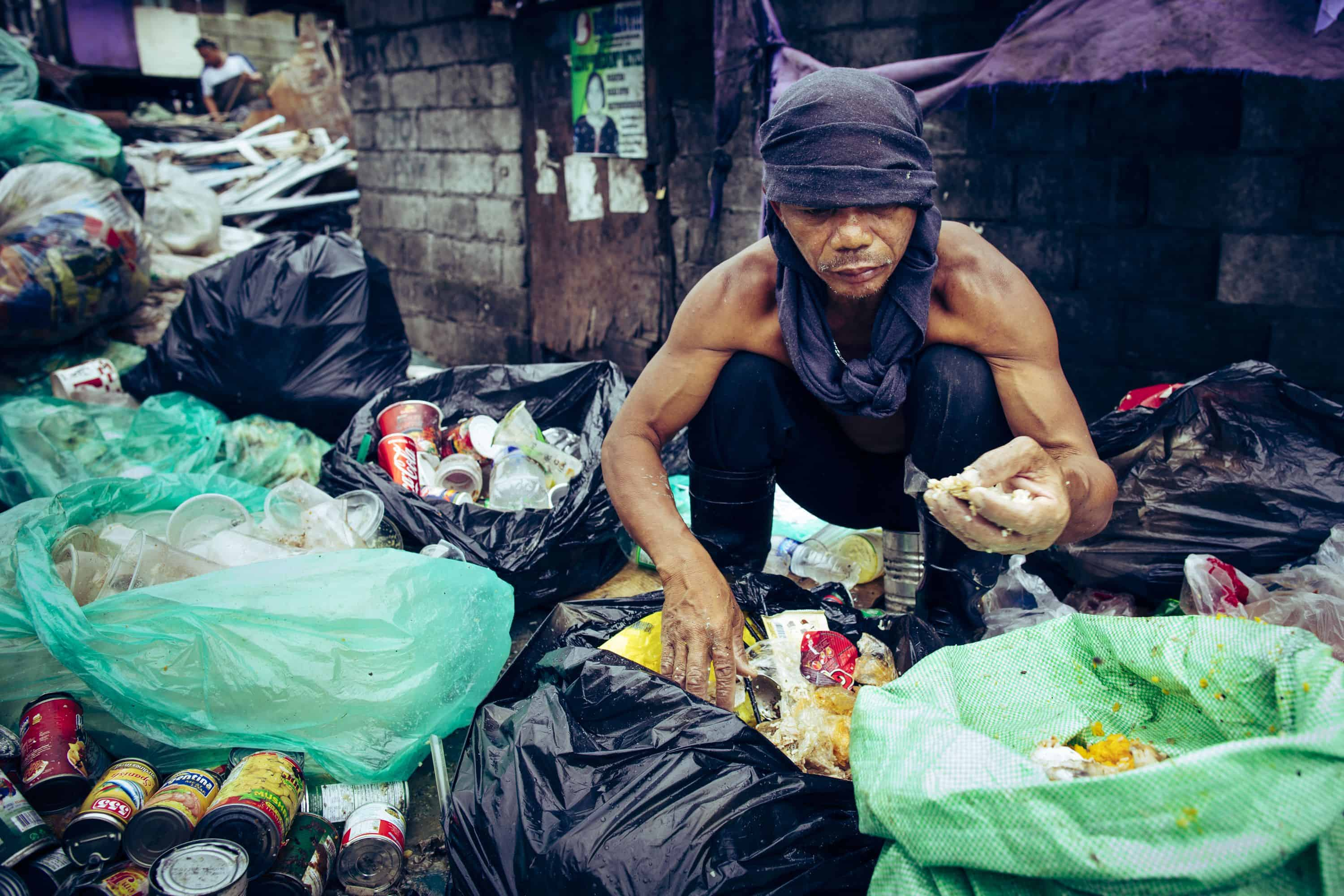 Scavenging for already-eaten food that can be recooked and sold is a common source of income in Tondo.