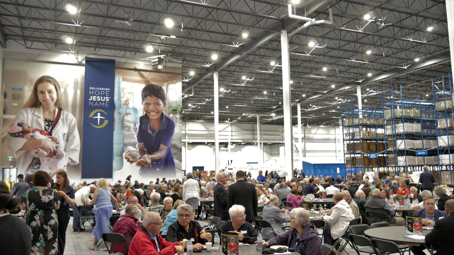 Guests enjoyed a meal at a temporary cafeteria set up in the new warehouse for the dedication and open house.
