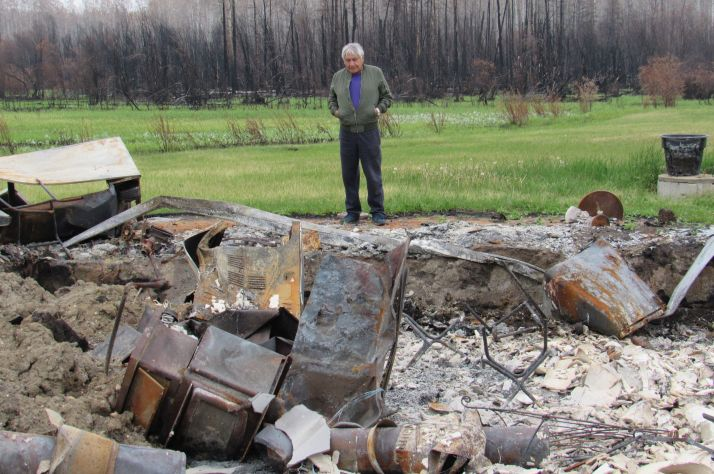 Wilson Gaucher looks over the remains of his home, destroyed by a wildfire.