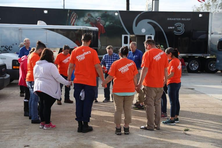 Samaritan's Purse volunteer teams start the day in prayer in Victoria, Texas