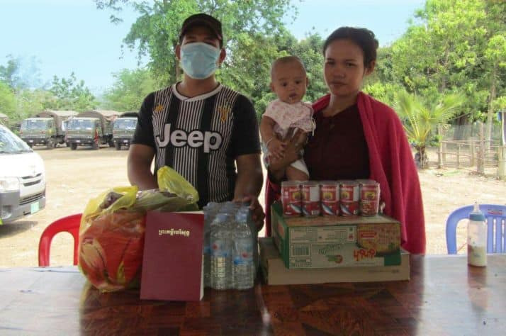 Life-saving provision: Tieng (left) and Saroeurn (right) were relieved to receive emergency food, including milk for their daughter, to help sustain them through the Coronavirus pandemic. They also took a Bible.