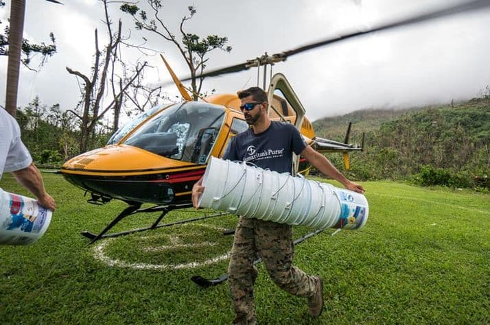 Samaritan's Purse staff member Ricky Geigel unloads relief supplies for a remote mountain community in Puerto Rico.