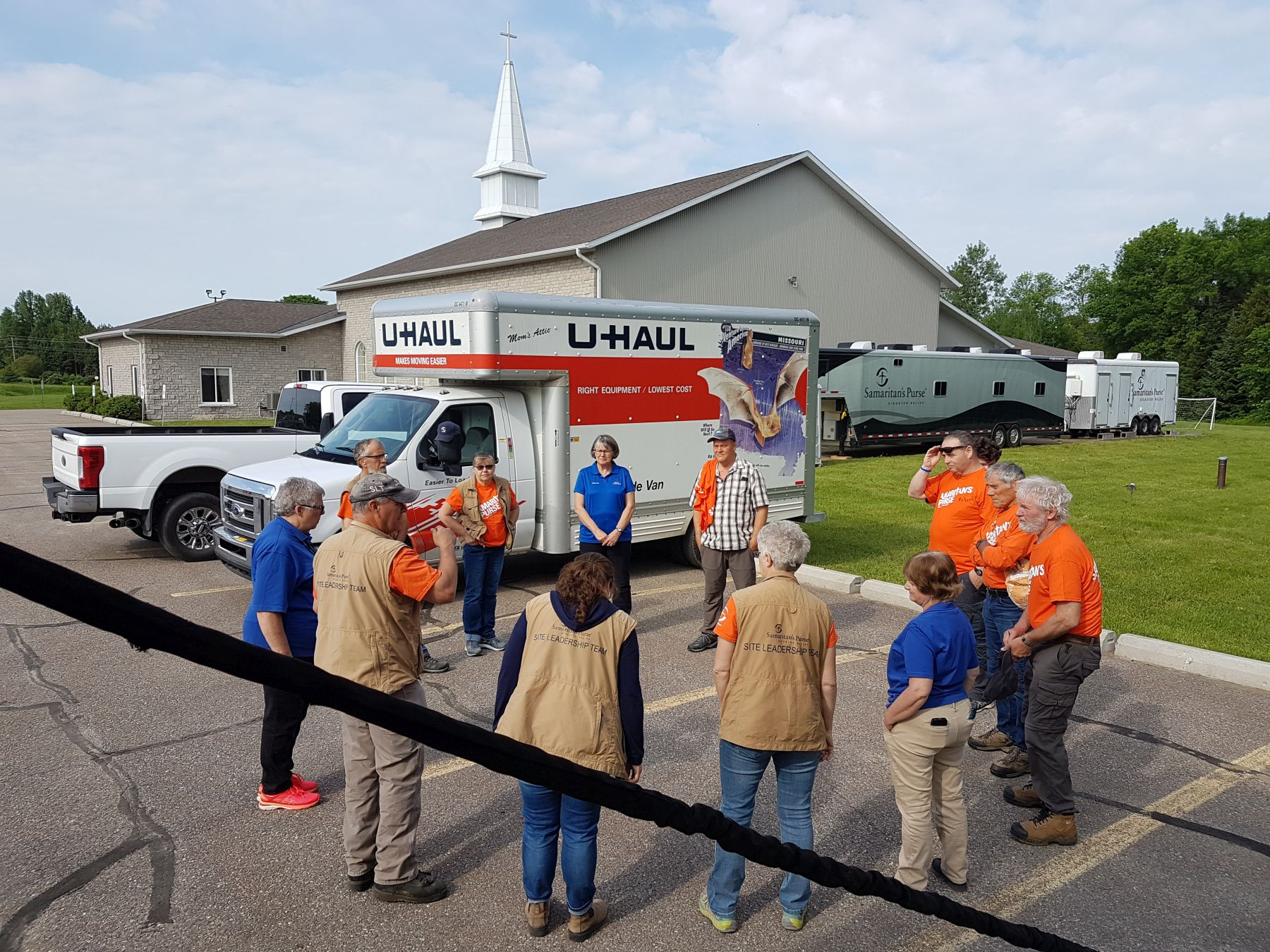 Samaritan's Purse volunteers pray with Billy Graham Rapid Response Team chaplains in Renfrew County, Ontario, pray before beginning their day of serving flood victims in Jesus' Name.