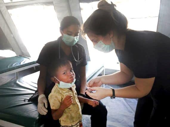 Canadian nurse Sharla Boody cares for a young patient in Bangladesh.