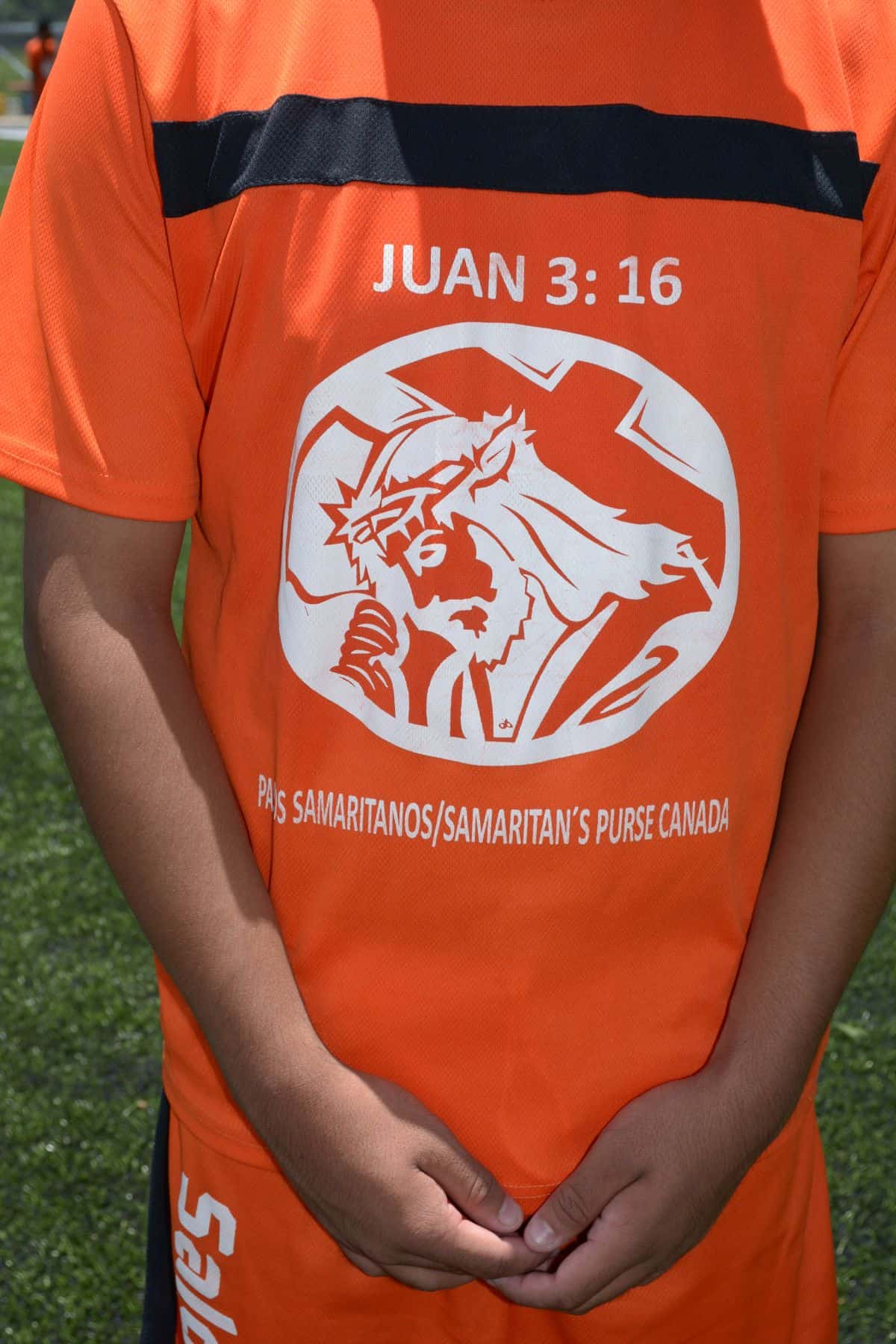 The shirt that each soccer player receives has a caricature of Jesus Christ and a prominent mention of John 3:16.