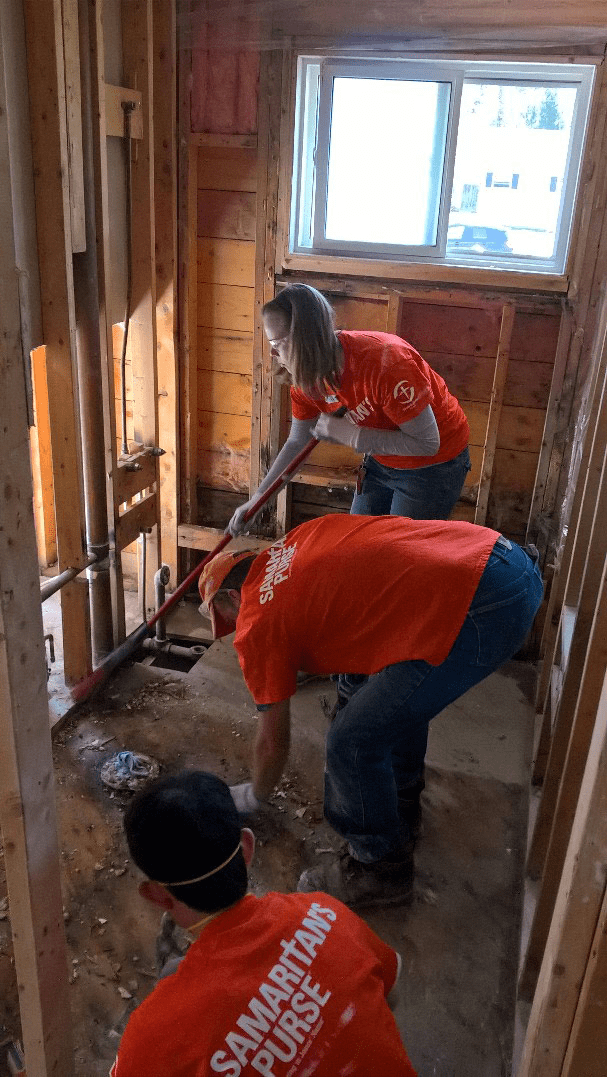 Samaritan's Purse trained volunteers help to remove mud, water and damaged possessions from basements from flooded homes in New Brunswick.