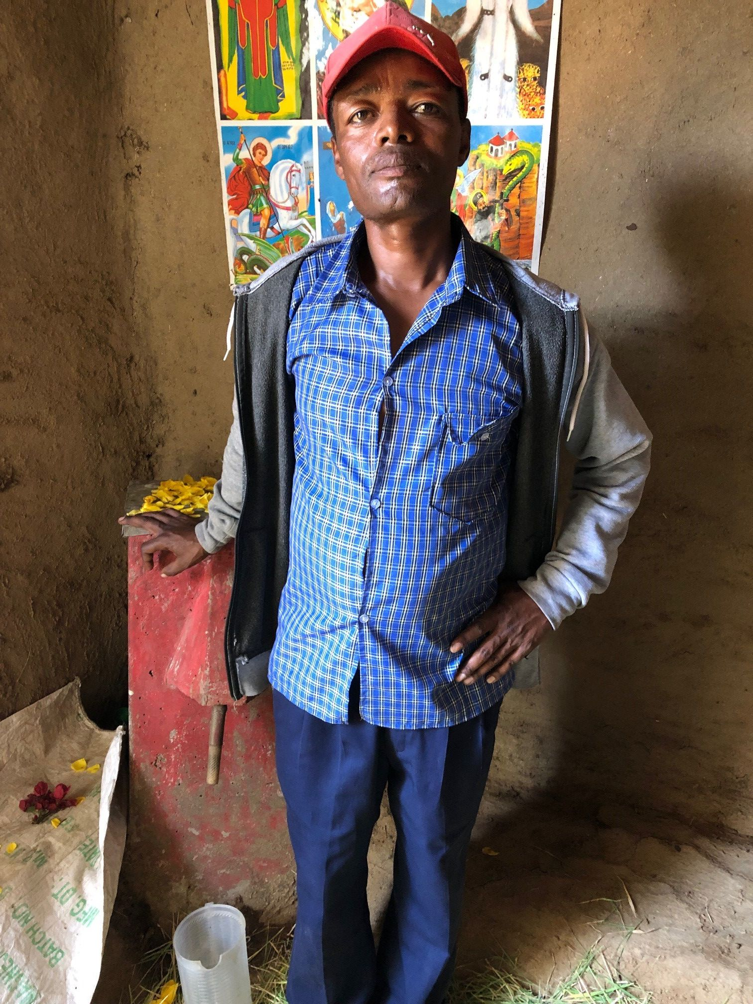 Seifu stands beside his life-saving BioSand Water Filter.