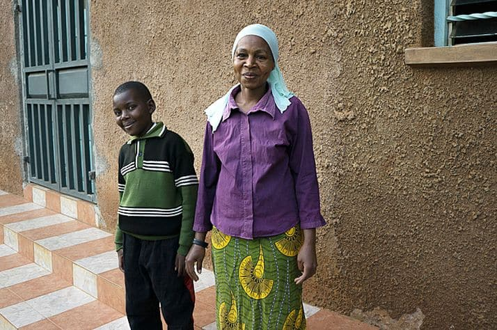 Clinton and Mary, his mom, smile in front of their new church home.